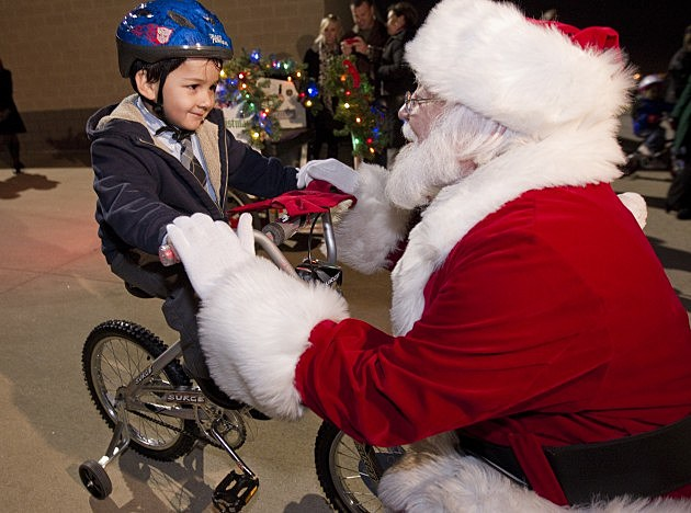Child receives bicycle from Santa