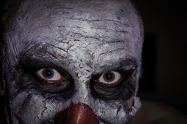 scary clown face isolated on black background colour image, horror